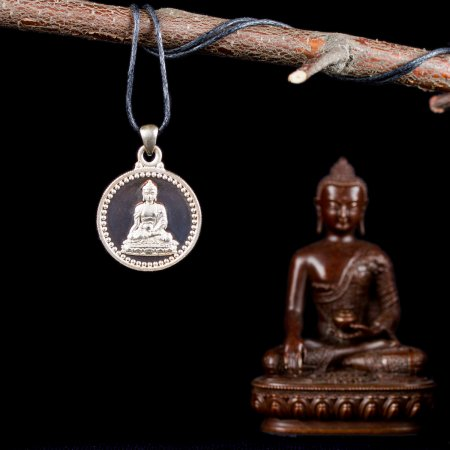 Tibetan Traditional Pendant Buddha Shakyamuni small perfection made from silver. Buy from our Buddhist adornments — DharmaCraft
