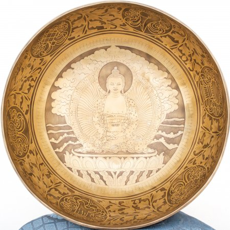 Himalayan Singing Bowl decorated with real carving of Buddha Amitabha aka Opame. High quality mix of 7 metals.