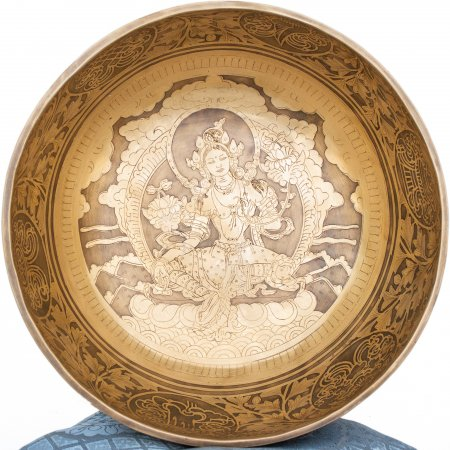 Himalayan Singing Bowl decorated with real carving of White Tara. High quality mix of 7 metals.